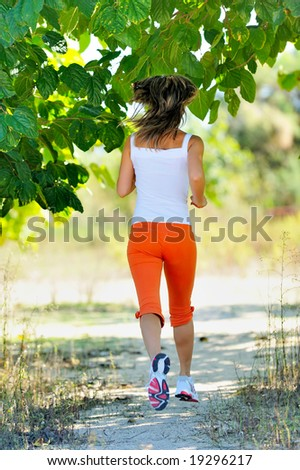 girl jogging in the park