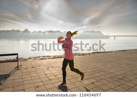 girl jogging on coasts river