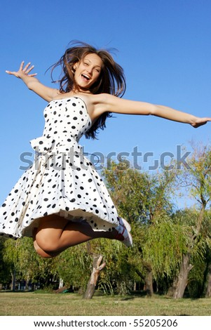 Girl jumping against blue sky