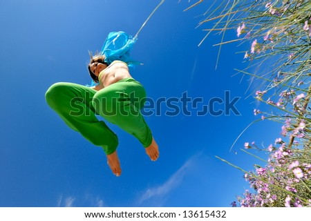 girl jumping and the blue sky