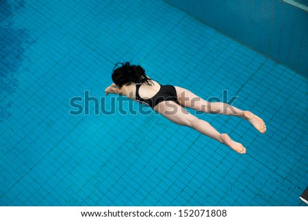 Public Swimming Pools With Diving Boards woman jumping diving board public swimming stock photo 152073395