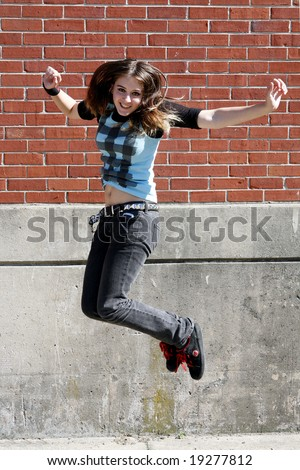 Girl Jumping in the air, excited.