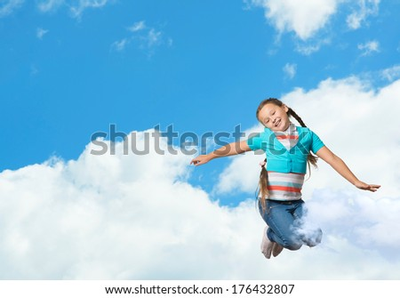 girl jumping on a background of blue sky