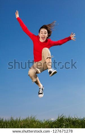 Girl jumping, running outdoor - stock photo