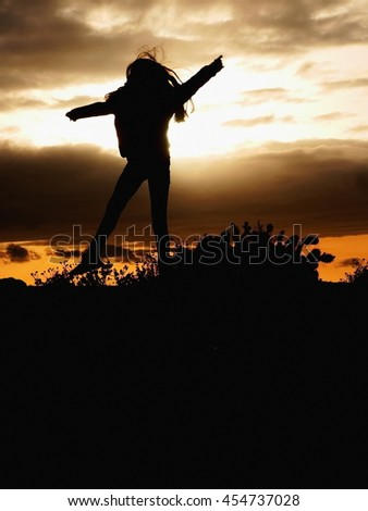 girl jumping silhouette - stock photo
