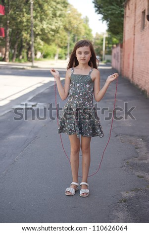 girl jumping with skipping rope - stock photo