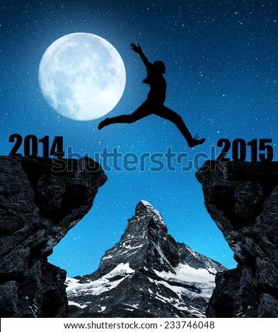 "Girl jumps to the New Year 2015 in the background mount Matterhorn. ""Elements of this image furnished by NASA"". - stock photo"