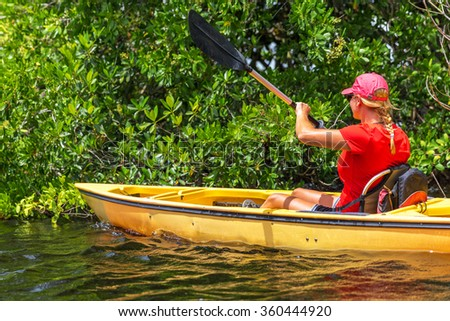 Girl kayaking in Everglades National park, Florida, USA, canoe sports - stock photo