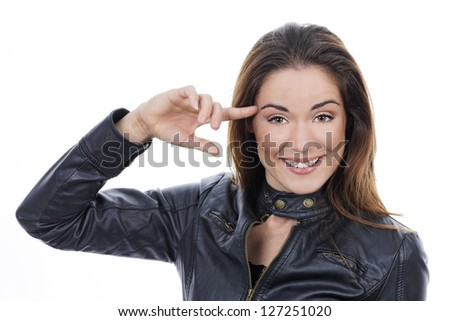 girl keep finger near head and show what you are crazy - stock photo