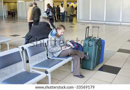 Girl keeps a record journeys in airport