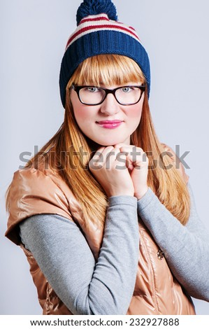 girl keeps hands in a cap together, is heated - stock photo