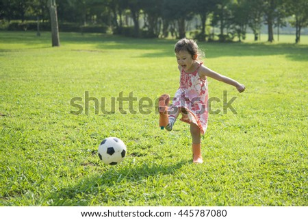 Girl kicking a soccer ball