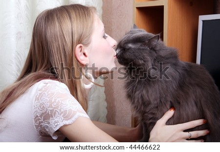 girl kissing a cat - stock photo