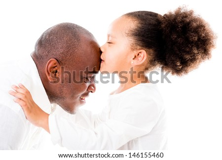 Girl kissing her father in the forehead - isolated over white backgorund  - stock photo