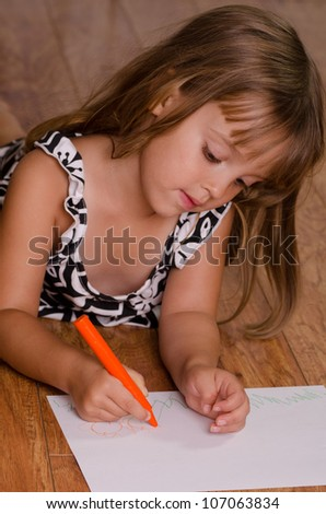 girl laying on floor drawing - stock photo