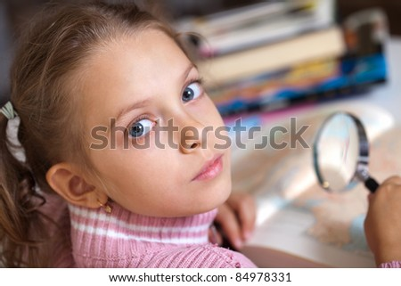girl learns the world around - stock photo