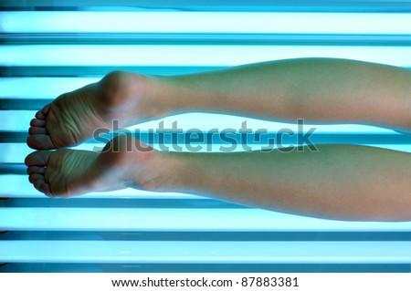 girl legs in a solarium - stock photo