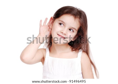 Girl listening, holding ear with hand