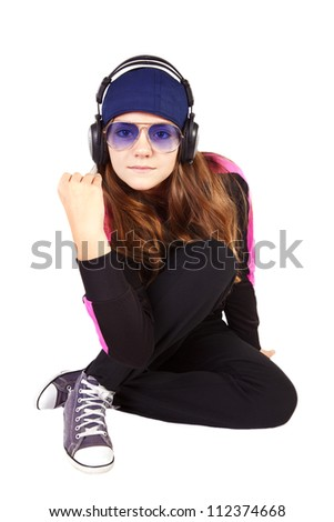 girl listening music by headphones isolated over white background