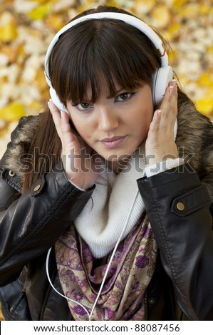 Girl listening music in the nature - stock photo