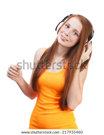 Girl listening  music on headphones. Isolated on white background - stock photo