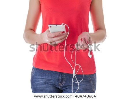 Girl listening to music in your phone. Silhouette on a white background. - stock photo