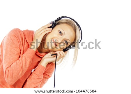 girl listening to music on headphones and looks isolated - stock photo