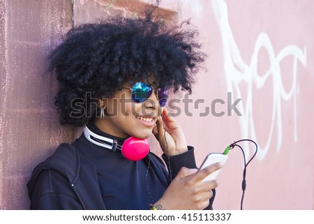 girl listening to music on the street