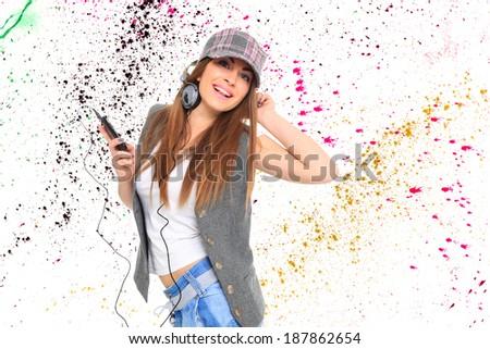 Girl Listening to Music over graffiti background - stock photo