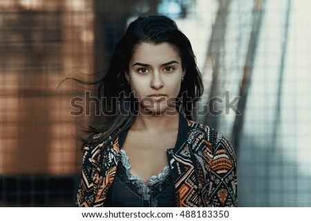 girl look into camera with strong face