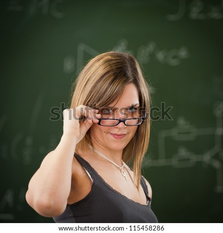 Girl looking above her reading glasses