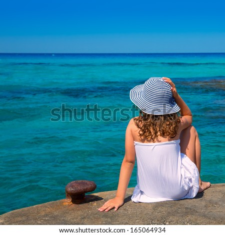 Girl looking at beach in Formentera turquoise Mediterranean sea background - stock photo