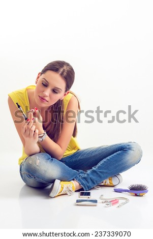 Girl looking at electronic cigarette - stock photo