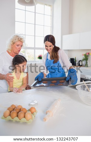 Girl looking at home-made cookies in the kitchen
