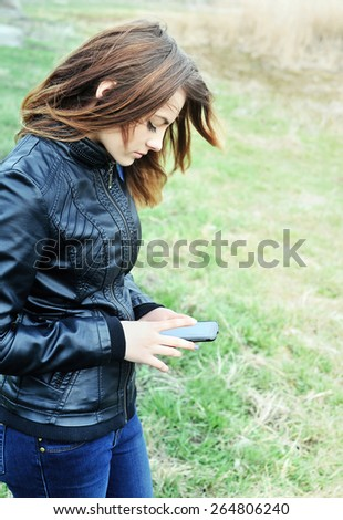 Girl looking at mobile phone  - stock photo