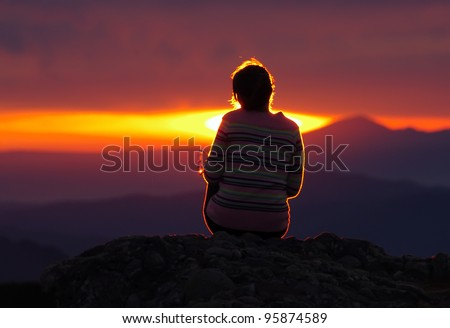 girl looking at sunset