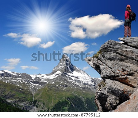 girl looking at the beautiful Mount Matterhorn in the Swiss Alps