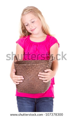girl looking down into empty basket, isolated on white - stock photo
