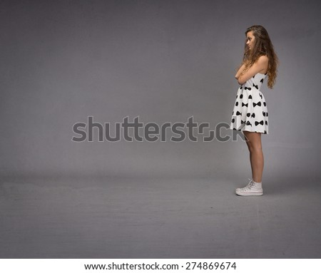 girl looking empty space, texture background - stock photo