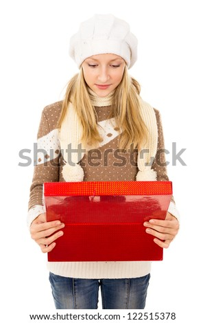 girl looking in a box - stock photo