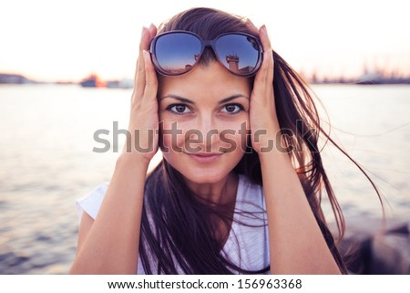 Girl looking in camera - stock photo