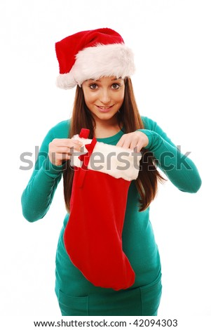 Girl looking in christmas stocking - stock photo