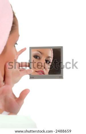 Girl looking you from mirror reflection - stock photo
