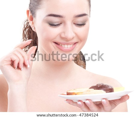 girl looks at sweets