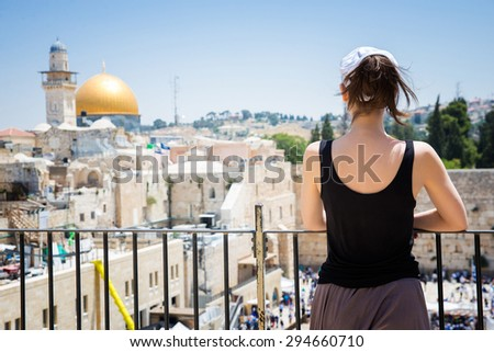 Girl looks at the Wailing Wall in Jerusalem - stock photo