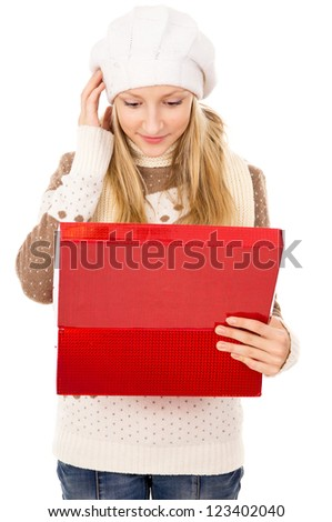 girl looks in a gift box and wondering isolated - stock photo