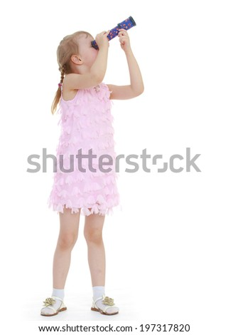 Girl looks through a telescope - stock photo