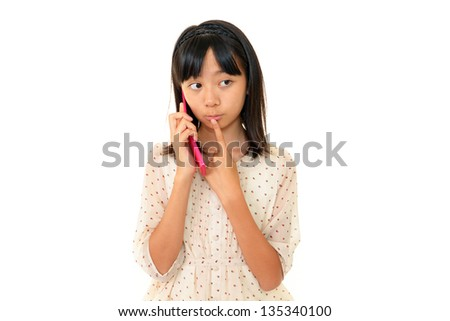 Girl looks uneasy with a cell phone