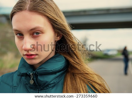 girl looks with caution - stock photo