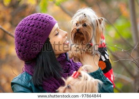 girl lovely look at small dog in her hands